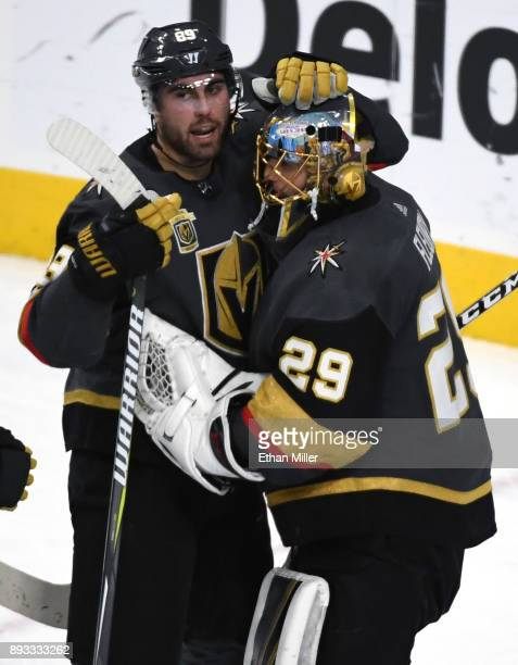 Alex Tuch of the Vegas Golden Knights congratulates teammate MarcAndre Fleury after their 21 victory over the Pittsburgh Penguins at TMobile Arena on...