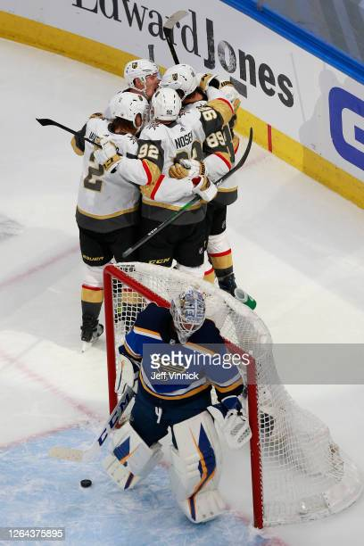 Alex Tuch of the Vegas Golden Knights is congratulated by his teammates after scoring a goal past Jordan Binnington of the St. Louis Blues during the...