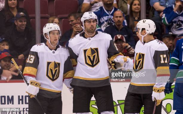 Alex Tuch of the Las Vegas Golden Knights is congratulated by teammates Brendan Leipsic and Nick Suzuki after scoring scoring against the Vancouver...