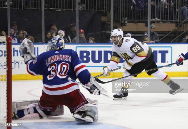 Alex Tuch of the Vegas Golden Knights is stopped by Henrik Lundqvist of the New York Rangers at Madison Square Garden in New York City The Golden...