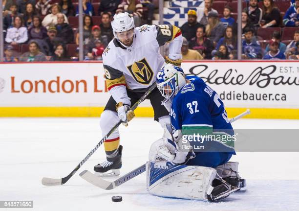 Alex Tuch of the Las Vegas Golden Knights is stopped in close by goalie Richard Backman of the Vancouver Canucks in NHL preseason action on September...