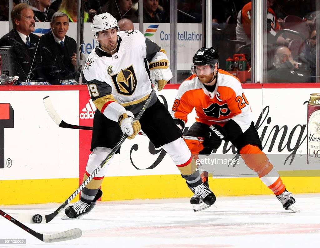 Alex Tuch #89 of the Vegas Golden Knights looks to pass as Claude Giroux #28 of the Philadelphia Flyers defends on March 12, 2018 at Wells Fargo Center in Philadelphia, Pennsylvania.