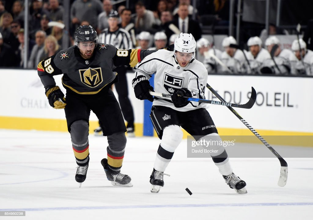 Alex Tuch #89 of the Vegas Golden Knights pressures Kale Clague #34 of the Los Angeles Kings as he skates with the puck during a preseason game at T-Mobile Arena on September 26, 2017 in Las Vegas, Nevada. Los Angeles won 3-2 in overtime.