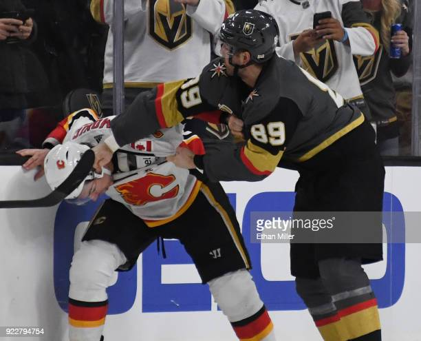 Alex Tuch of the Vegas Golden Knights punches Travis Hamonic of the Calgary Flames during a fight in the third period of their game at TMobile Arena...