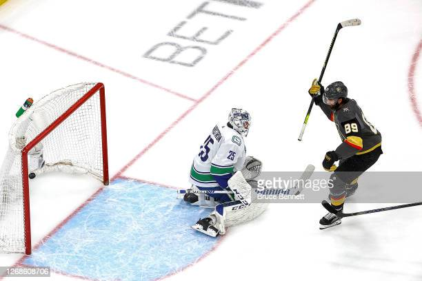 Alex Tuch of the Vegas Golden Knights scores a goal past Jacob Markstrom of the Vancouver Canucks during the second period in Game Two of the Western...