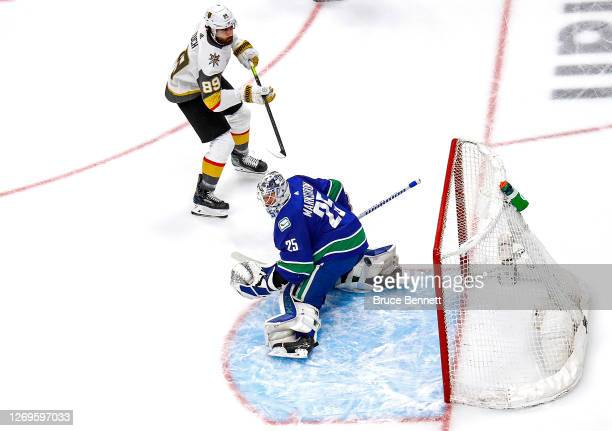 Alex Tuch of the Vegas Golden Knights scores a goal past Jacob Markstrom of the Vancouver Canucks during the first period in Game Three of the...
