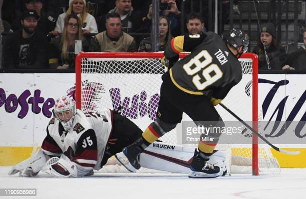 Alex Tuch of the Vegas Golden Knights scores the game-winning goal during a shootout against Darcy Kuemper of the Arizona Coyotes to win the game 2-1...
