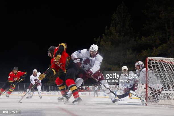 Alex Tuch of the Vegas Golden Knights shoots to score a third period goal past Nazem Kadri and goaltender Philipp Grubauer of the Colorado Avalanche...