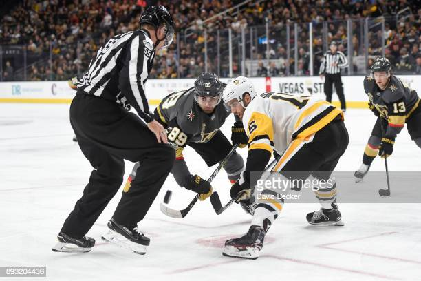 Alex Tuch of the Vegas Golden Knights takes a faceoff against Riley Sheahan of the Pittsburgh Penguins during the game at TMobile Arena on December...