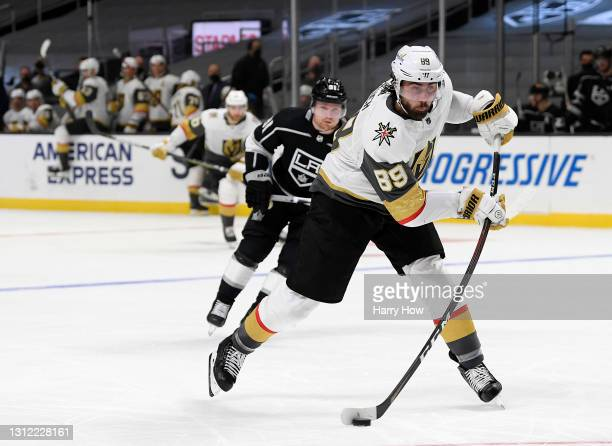 Alex Tuch of the Vegas Golden Knights takes a shot in front of Carl Grundstrom of the Los Angeles Kings during the third period in a 4-2 Knights win...