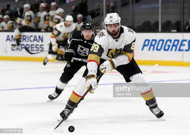 Alex Tuch of the Vegas Golden Knights takes control of the puck in front of Carl Grundstrom of the Los Angeles Kings during the third period in a 4-2...