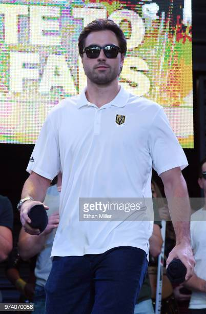 Alex Tuch of the Vegas Golden Knights throws Tshirts to the crowd as he is introduced at the team's 'Stick Salute to Vegas and Our Fans' event at the...