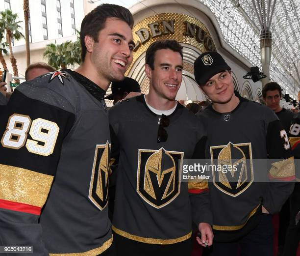 Alex Tuch, Reilly Smith and Reid Duke of the Vegas Golden Knights pose for photos as they walk a red carpet at the Vegas Golden Knights Fan Fest at...