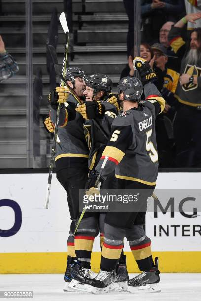Alex Tuch Shea Theodore and Deryk Engelland of the Vegas Golden Knights celebrate after scoring a goal against the Nashville Predators during the...