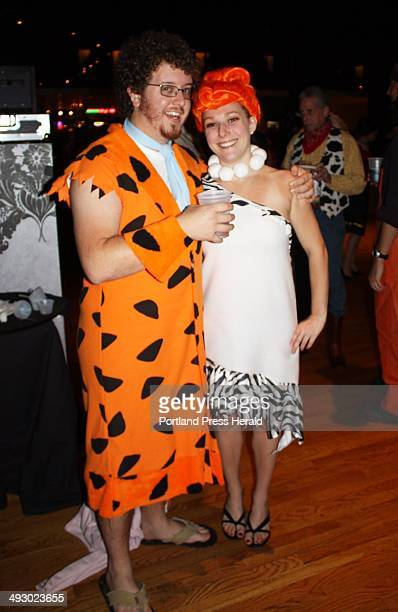 Alex Tuck dressed as Fred Flintstone and Gillian Gelder dressed as Wilma Flintstone staff photo