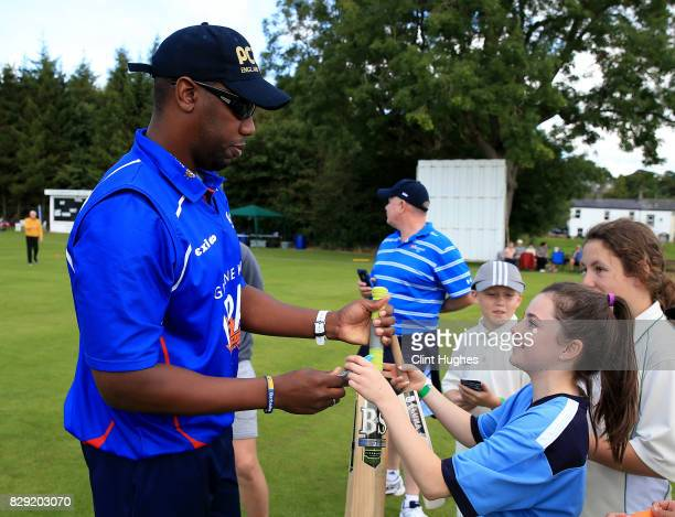 Alex Tudor signs an autograph for a fan during the PCA England Masters Day at Cockermouth Cricket Club on August 10, 2017 in Cockermouth, England.
