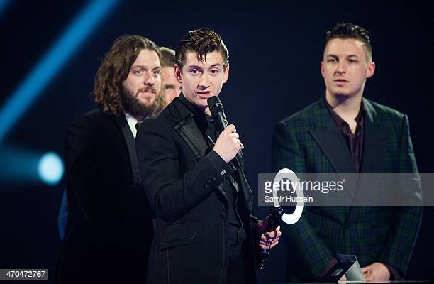 Alex Turner Jamie Cook Nick O'Malley and Matt Helders of Arctic Monkeys accept their Best Album Award onstage at The BRIT Awards 2014 at The O2 Arena...