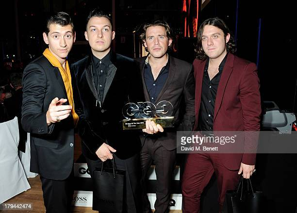 Alex Turner Matt Helders Jamie Cook and Nick O'Malley of The Arctic Monkeys attend the GQ Men of the Year awards at The Royal Opera House on...