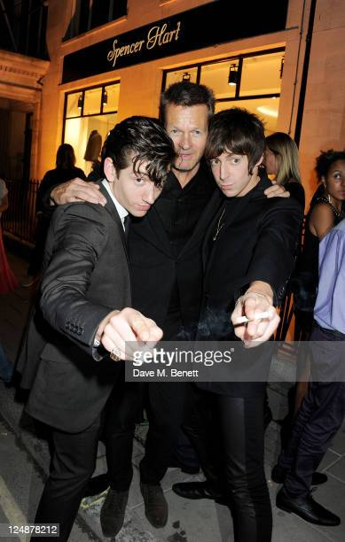 Alex Turner Nick Hart and Miles Kane attend the opening of the new Spencer Hart shop on September 13 2011 in London England