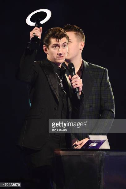 Alex Turner of Arctic Monkeys receives the award for British Group at The BRIT Awards 2014 at 02 Arena on February 19 2014 in London England