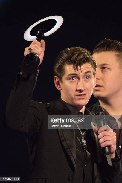 Alex Turner of The Arctic Monkeys holds up a BRIT award to onstage at The BRIT Awards 2014 at The O2 Arena on February 19 2014 in London England