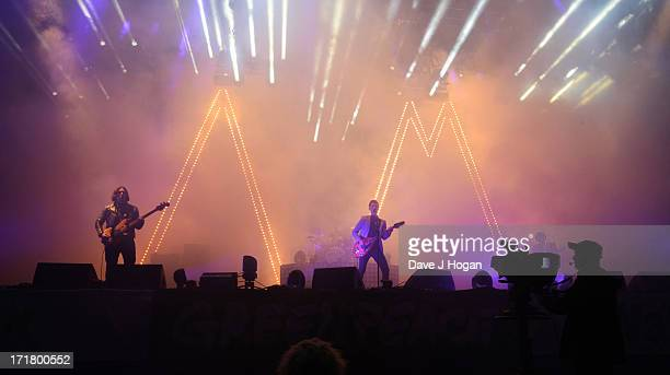 Alex Turner of The Arctic Monkeys performs at day 2 of the 2013 Glastonbury Festival at Worthy Farm on June 28 2013 in Glastonbury England