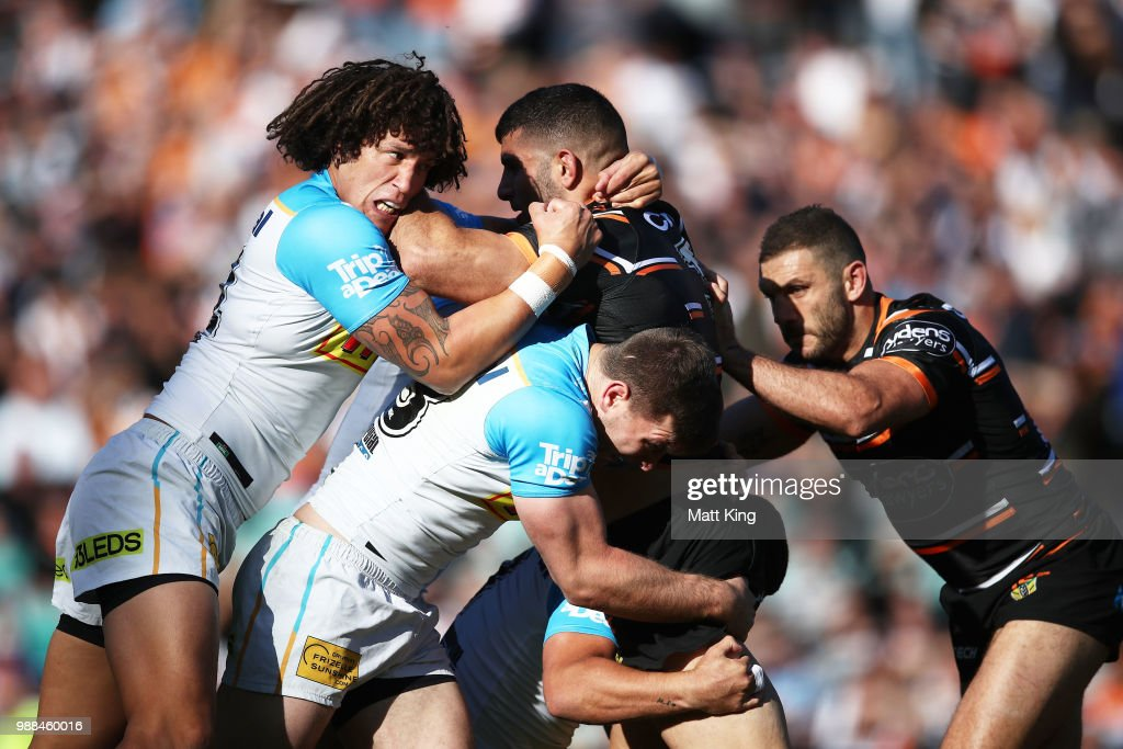 Alex Twal of the Tigers is tackled by Kevin Proctor of the Titans during the round 16 NRL match between the Wests Tigers and the Gold Coast Titans at Leichhardt Oval on July 1, 2018 in Sydney, Australia.