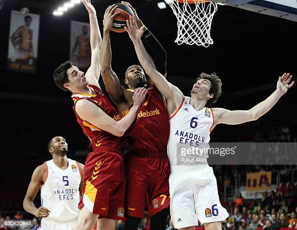 Alex Tyus #7 of Galatasaray Odeabank Istanbul competes with Cedi Osman #6 of Anadolu Efes Istanbul during the 2016/2017 Turkish Airlines EuroLeague...