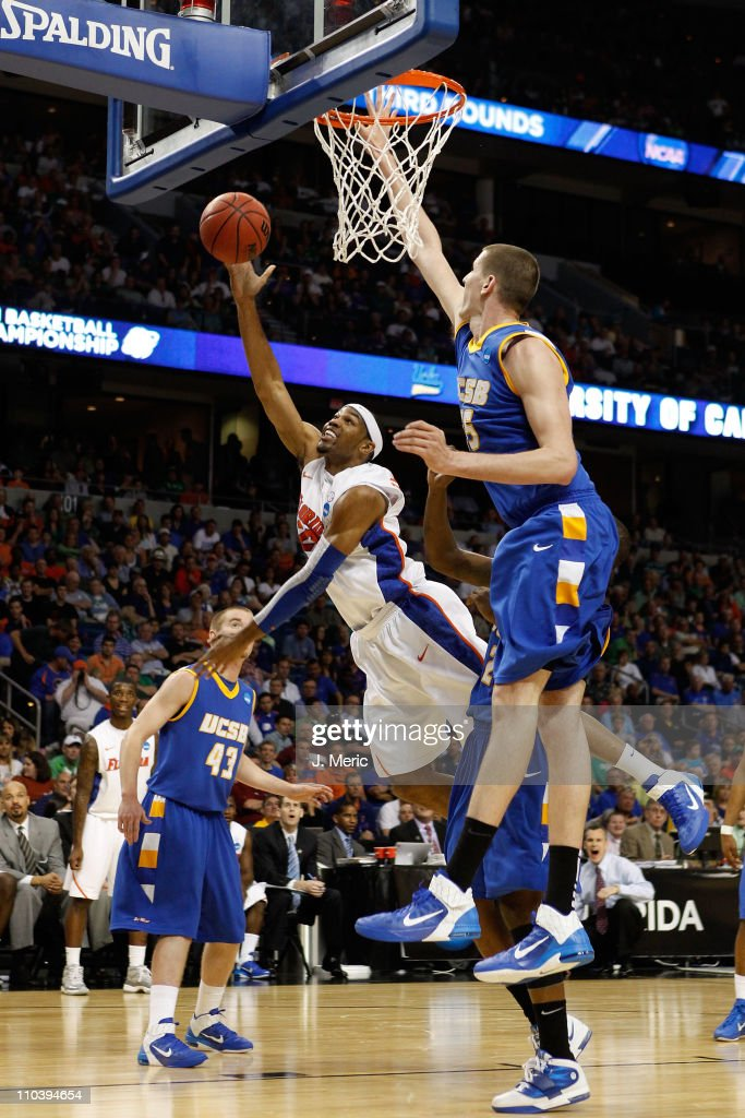 Alex Tyus #23 of the Florida Gators drives for a shot attempt against Greg Somogyi #55 of the UC Santa Barbara Gauchos during the second round of the 2011 NCAA men's basketball tournament at St. Pete Times Forum on March 17, 2011 in Tampa, Florida.