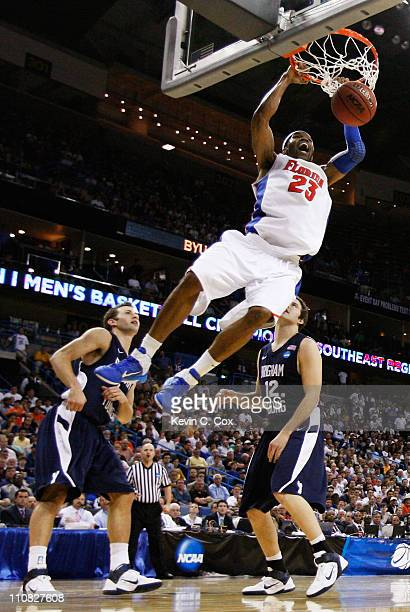 Alex Tyus of the Florida Gators dunks against the Brigham Young Cougars during the Southeast regional of the 2011 NCAA men's basketball tournament at...