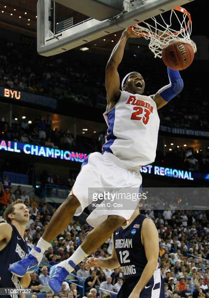 Alex Tyus of the Florida Gators dunks during their 83 to 74 win over the Brigham Young Cougars in the Southeast regional of the 2011 NCAA men's...