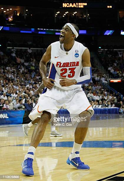 Alex Tyus of the Florida Gators reacts aftr dunking during their 83 to 74 win over the Brigham Young Cougars in the Southeast regional of the 2011...