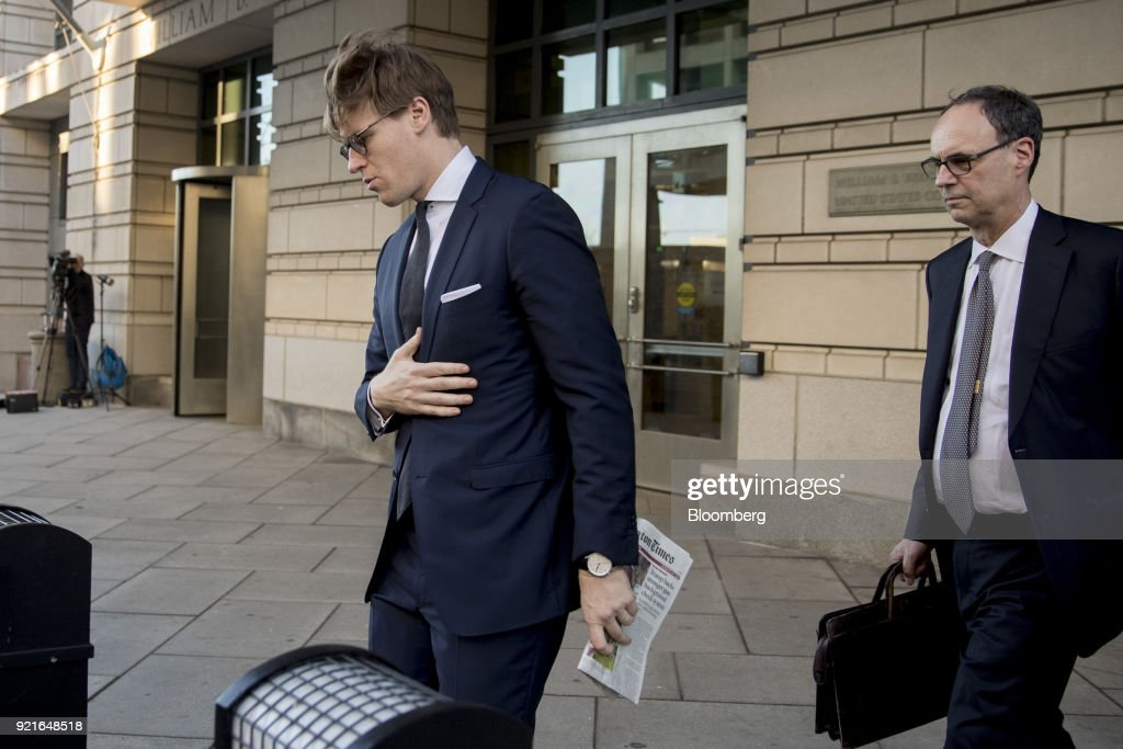 Alex Van der Zwaan, former associate at Skadden Arps Slate Meagher & Flom UK LLP, left, exits Federal Court in Washington, D.C., U.S. on Tuesday, Feb. 20, 2018. Van der Zwaan was charged on February 16 with making false statements to federal authorities as part of Special Counsel Robert Mueller's probe of Russian collusion in the 2016 presidential election. Photographer: Andrew Harrer/Bloomberg via Getty Images