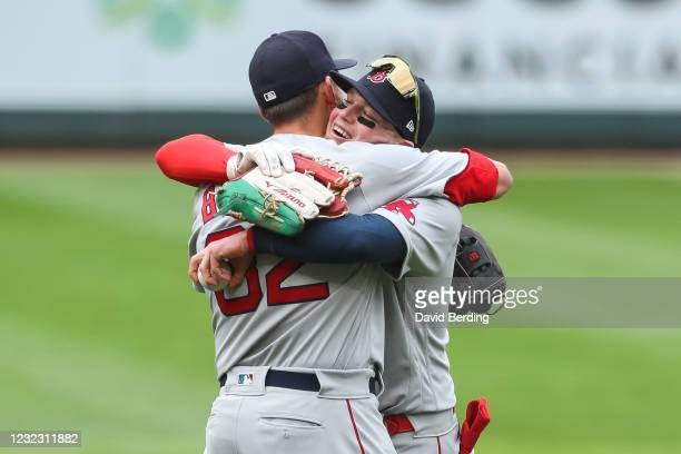 Alex Verdugo and Matt Barnes of the Boston Red Sox celebrate their victory against the Minnesota Twins during game one of a doubleheader at Target...