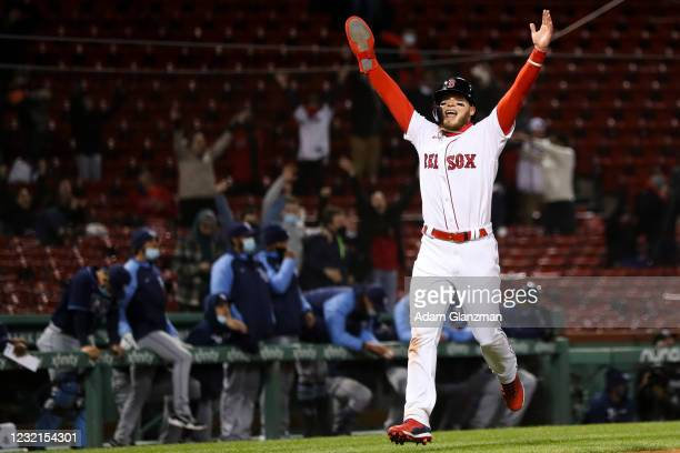 Alex Verdugo celebrates as he scores after J.D. Martinez of the Boston Red Sox hits a walk off two-run shot in the twelfth inning of a game against...