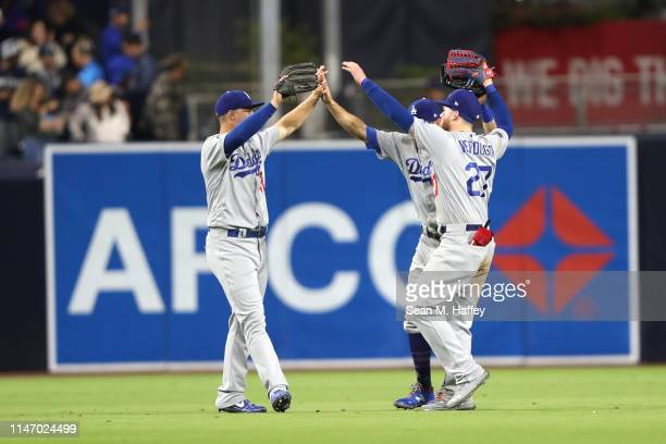 Alex Verdugo Joc Pederson and Chris Taylor of the Los Angeles Dodgers celebrate defeating the San Diego Padres 76 in a game at PETCO Park on May 04...