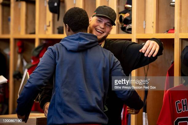 Alex Verdugo of the Boston Red Sox high fives Jeter Downs as he arrives during a team workout on February 15 2020 at JetBlue Park at Fenway South in...