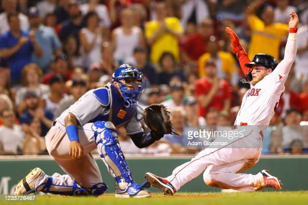 Alex Verdugo of the Boston Red Sox scores ahead of the throw to catcher Salvador Perez of the Kansas City Royals in the sixth inning at Fenway Park...