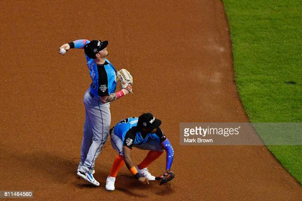 Alex Verdugo of the Los Angeles Dodgers and the World Team fields a ball over Ronald Acuna of the Atlanta Braves and the World Team during the...