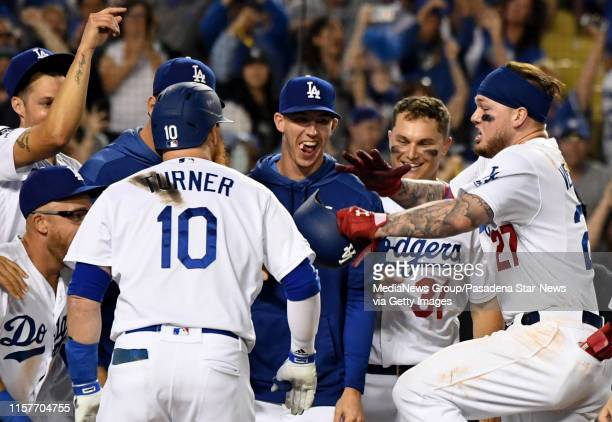 Alex Verdugo of the Los Angeles Dodgers celebrates after hitting the game winning home run to defeat the Colorado Rockies 54 in eleven innings of a...