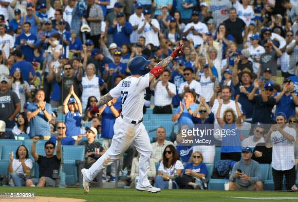 Alex Verdugo of the Los Angeles Dodgers celebrates his solo home run after crossing home plate against the Colorado Rockies in the fifth inning at...