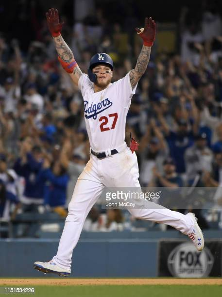 Alex Verdugo of the Los Angeles Dodgers celebrates running to second base after his 11th inning walkoff home run defeated the Colorado Rockies 54 at...