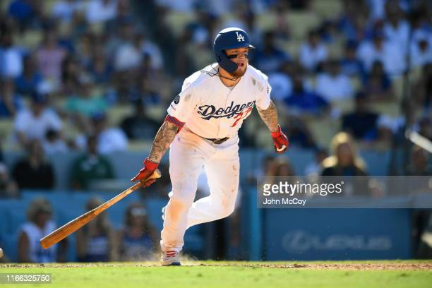 Alex Verdugo of the Los Angeles Dodgers gets a hit against the San Diego Padres in the ninth inning at Dodger Stadium on August 4 2019 in Los Angeles...