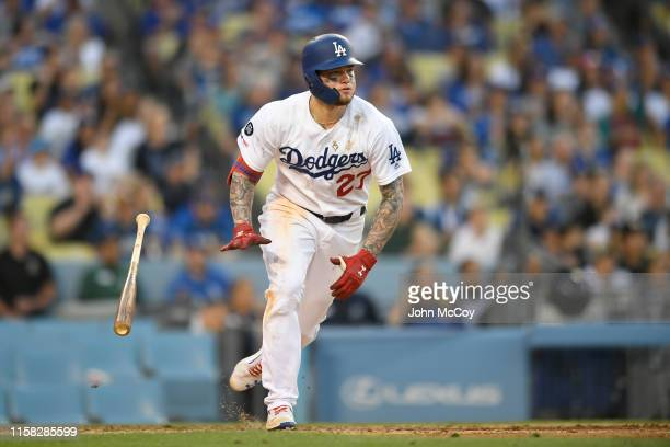Alex Verdugo of the Los Angeles Dodgers gets a single against Carlos Estevez of the Colorado Rockies in the ninth inning at Dodger Stadium on June 22...