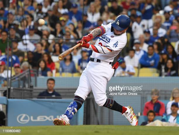 Alex Verdugo of the Los Angeles Dodgers hits a sacrifice fly to score Chris Taylor of the Los Angeles Dodgers in the fifth inning at Dodger Stadium...