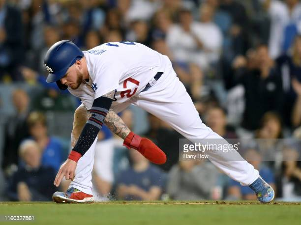 Alex Verdugo of the Los Angeles Dodgers reaches for home plate to tie the game 22 during the sixth inning at Dodger Stadium on July 05 2019 in Los...