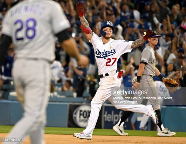 Alex Verdugo of the Los Angeles Dodgers reacts after hitting the game winning home run to defeat the Colorado Rockies 54 in eleven innings of a MLB...