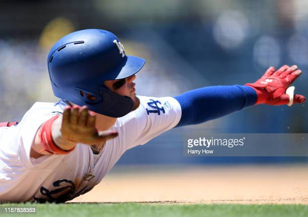 Alex Verdugo of the Los Angeles Dodgers reacts to his slide at first base despite being called out to end the third inning against the Colorado...