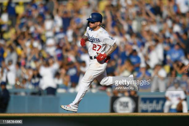 Alex Verdugo of the Los Angeles Dodgers rounds the bases after hitting a home run against the Colorado Rockies at Dodger Stadium on June 22 2019 in...