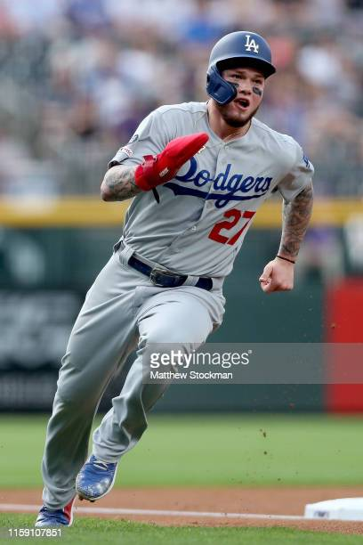 Alex Verdugo of the Los Angeles Dodgers rounds third base to score on a Cody Bellinger double in the first inning against the Colorado Rockies at...